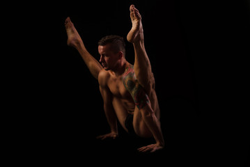 young man in yoga and gymnastics, posture Locust