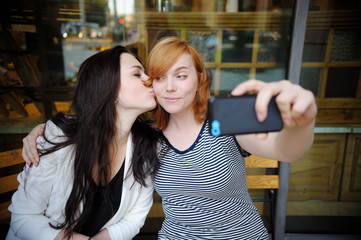 Two young girls making selfie