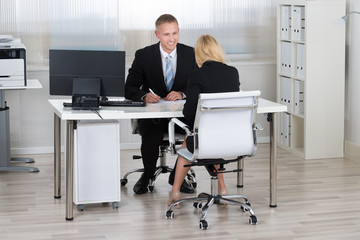 Businessman With Candidate During Interview In Office