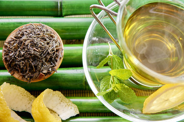 Oriental green tea with mint and lemon on bamboo top