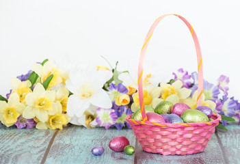 Chocolate eggs in a pink Easter basket