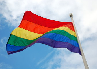 Rainbow flag (LGBT movement) on the sky background