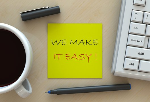 WE MAKE IT EASY!, message on note paper, computer and coffee on table