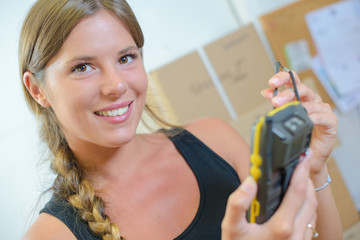 woman using a hand-held inventory device