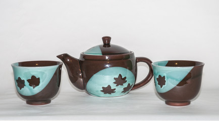 Complementos del té: juego de té, taza, tetera, accesorios