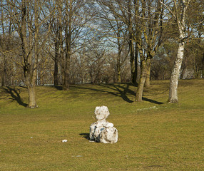 Snowman on field with no snow anymore around
