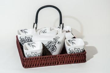 Complementos del té: juego de té, teteta, taza, accesorio