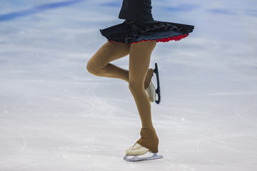 closeup slender legs girls athletes figure skater. part of body, without a face
