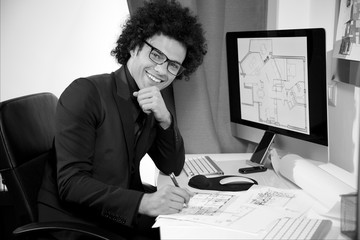 Happy young architect smiling in office looking camera