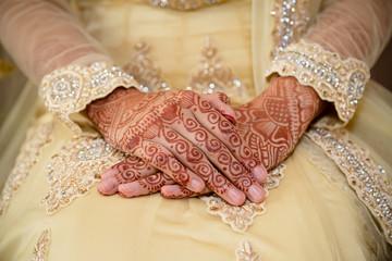 crossed henna hands