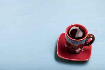 Coffee in cup on blue wooden table
