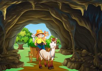 Man riding wagon through the cave