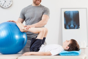Physiotherapy with fitness ball