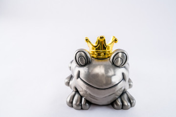Happy frog valentine prince with golden crown.