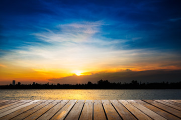 Wooden walkway on sunset background