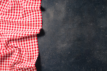 Red tablecloth on dark table