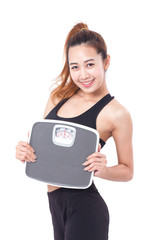Dieting, Sport women with weight scale.