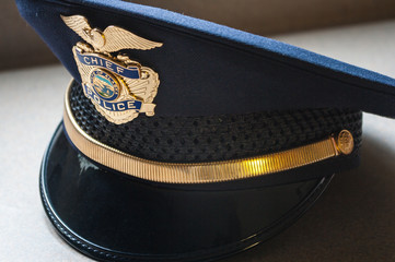 Closeup of a blue municipal Police Chief hat.  Alaska.