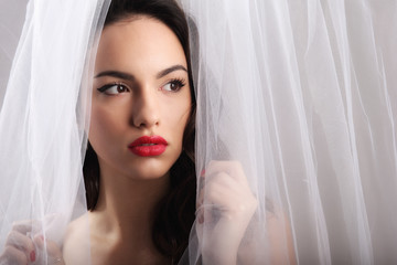 Beautiful girl with a white tulle