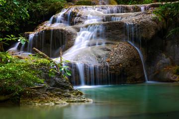 waterfall, green fern, green water in forest