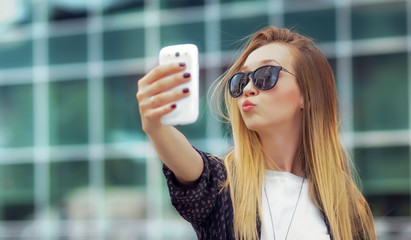 Trendy girl make a selfie
