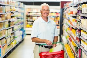 Senior man buying food