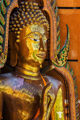 Golden buddha statue with mountain, Wat Tham Sua(Tiger Cave Temp
