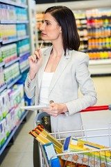 Pretty woman looking at product on shelf