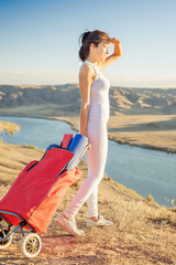 Happy asian woman with yoga mat going to fitness exercises