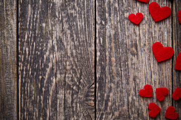 Brown wooden background with red hearts.