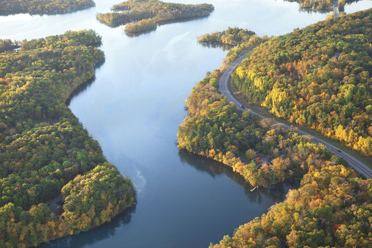 Curving road along Mississippi River during autumn