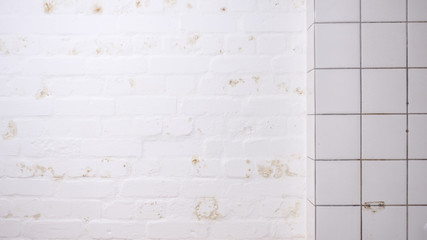 white tiles and brick wall, grunge background