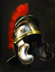 Roman soldier helmet in black background