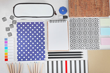 Notebooks with stationery and pencil case on a white table