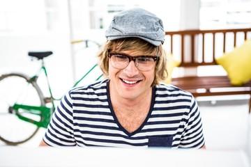 Smiling hipster businessman