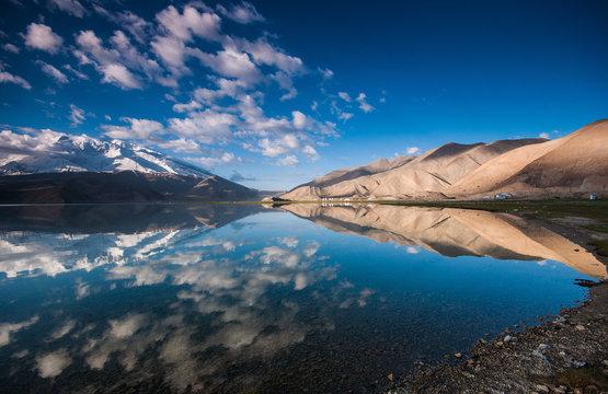 Stunning landscape reflection of Karakul lake in Xinjiang, China.
