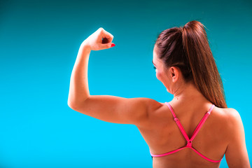 Girl swimmer showing muscles fit body