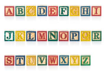 Colorful wood alphabet blocks isolated on white