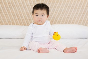 Cute baby holding plastic duck