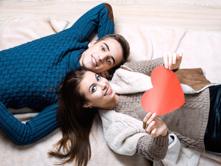 happy couple holding red heart