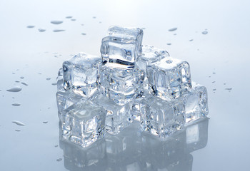 Square ice cubes on white background