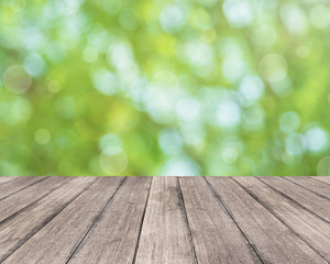 Wooden plank and bright spring bokeh background - can be used for display your products