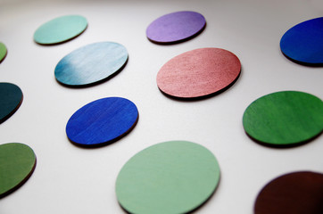 Photo of colorful wooden wheels, laser cut and hand-painted with acrylic paints