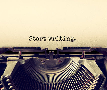 close up image of typewriter with paper sheet and the phrase: start writing . copy space for your text. terto filtered