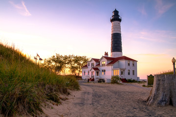 The Big Sable Lighthouse illuminated by the golden rays of the setting sun. Ludington State Park. Ludington, Michigan. The lighthouse is only accessible by foot after a mile and a half hike. Wall mural