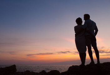 Loving couple sunset silhouette
