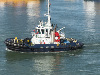 Tugboat crusing in harbor
