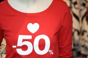 Sale, shopping at 50 % discount