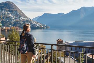 Young girl looking at the panoramic scenery. Lugano, Switzerland