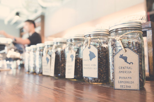 display of specialty coffee beans in coffee shop, vintage tone a